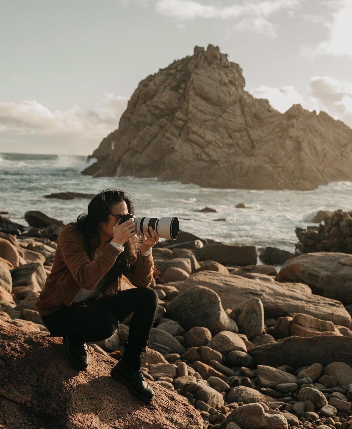Man holding a camera Jarrad Seng