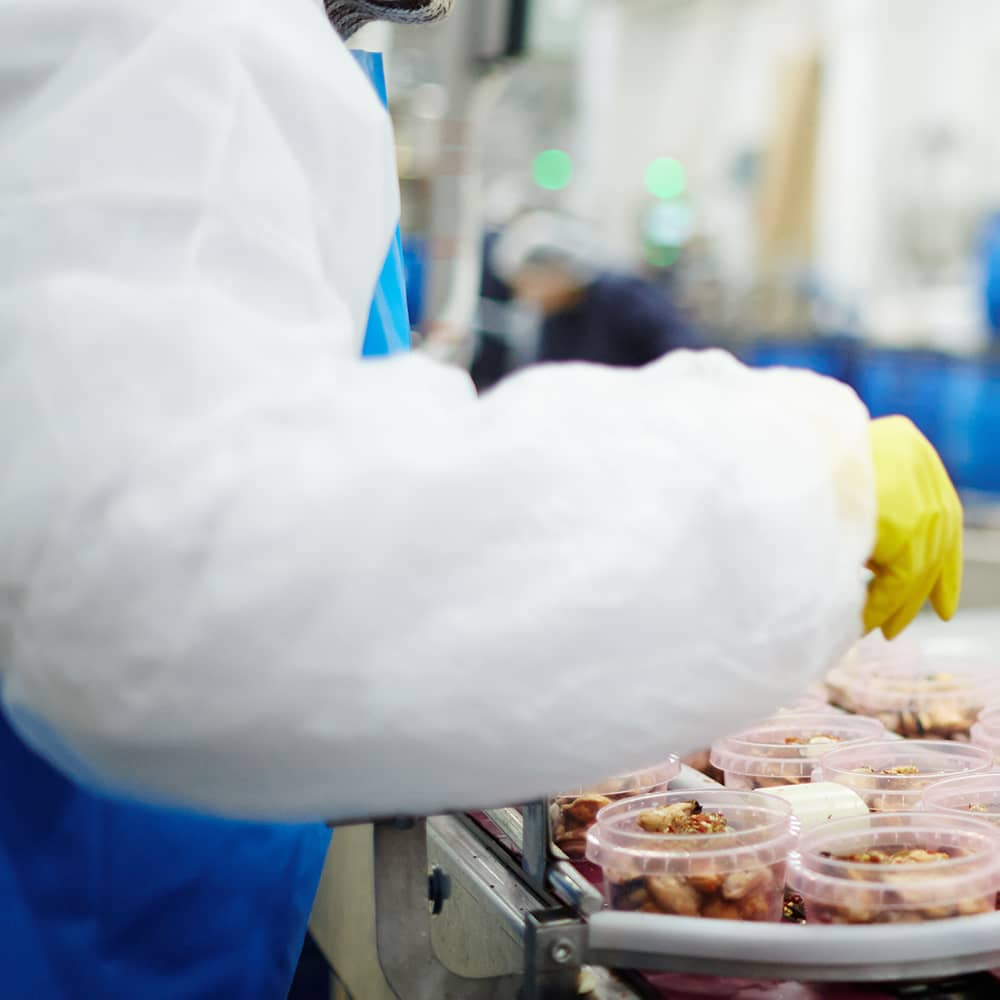 Photo of a woman working at a food plant
