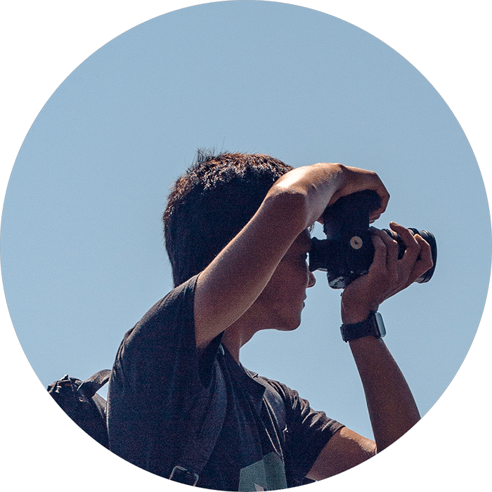 Photo of Ronan Furuta, using a camera