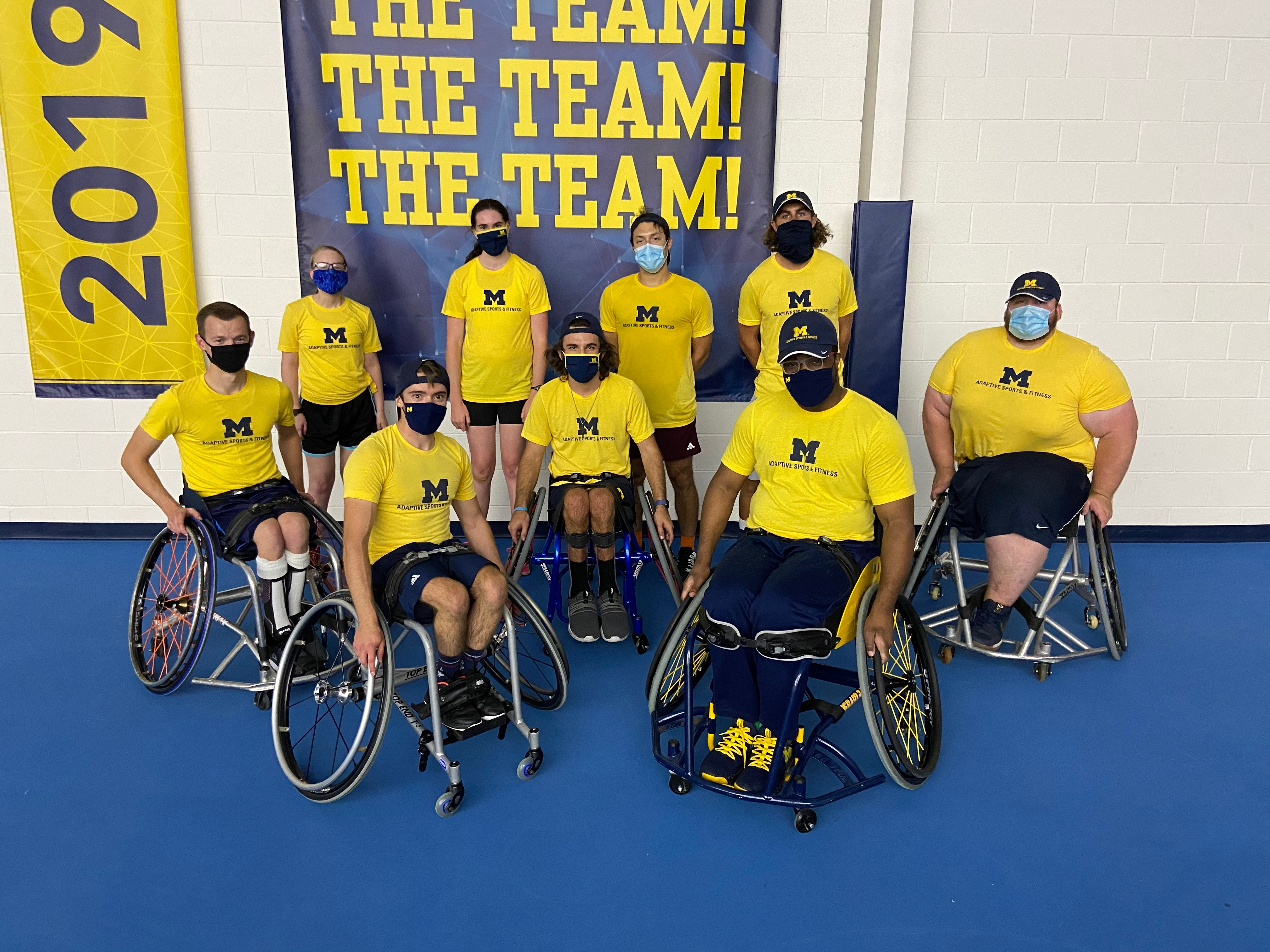 The adaptive sports and fitness team at a wheelchair tennis practice.