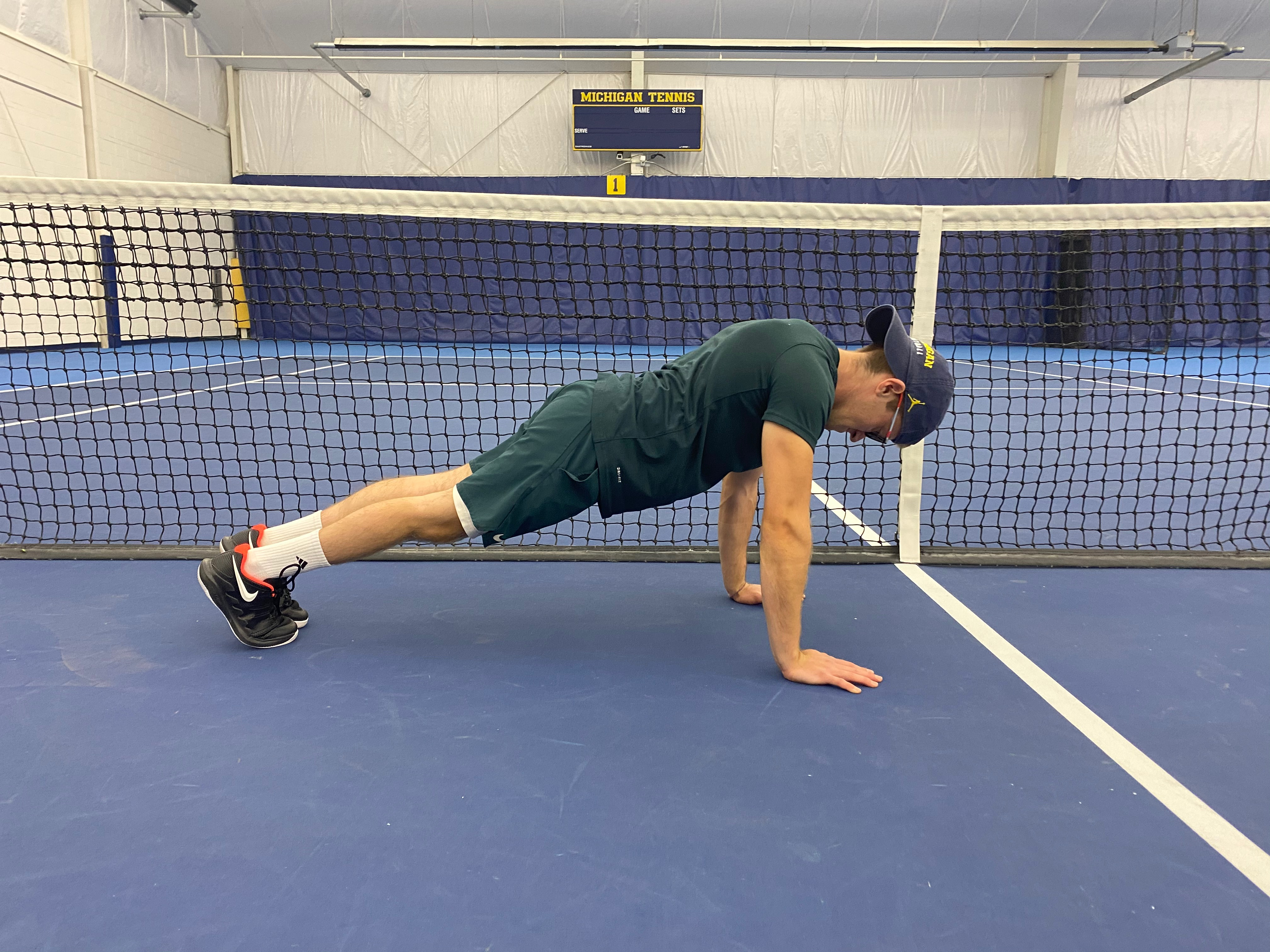 An athlete demonstrates a push up