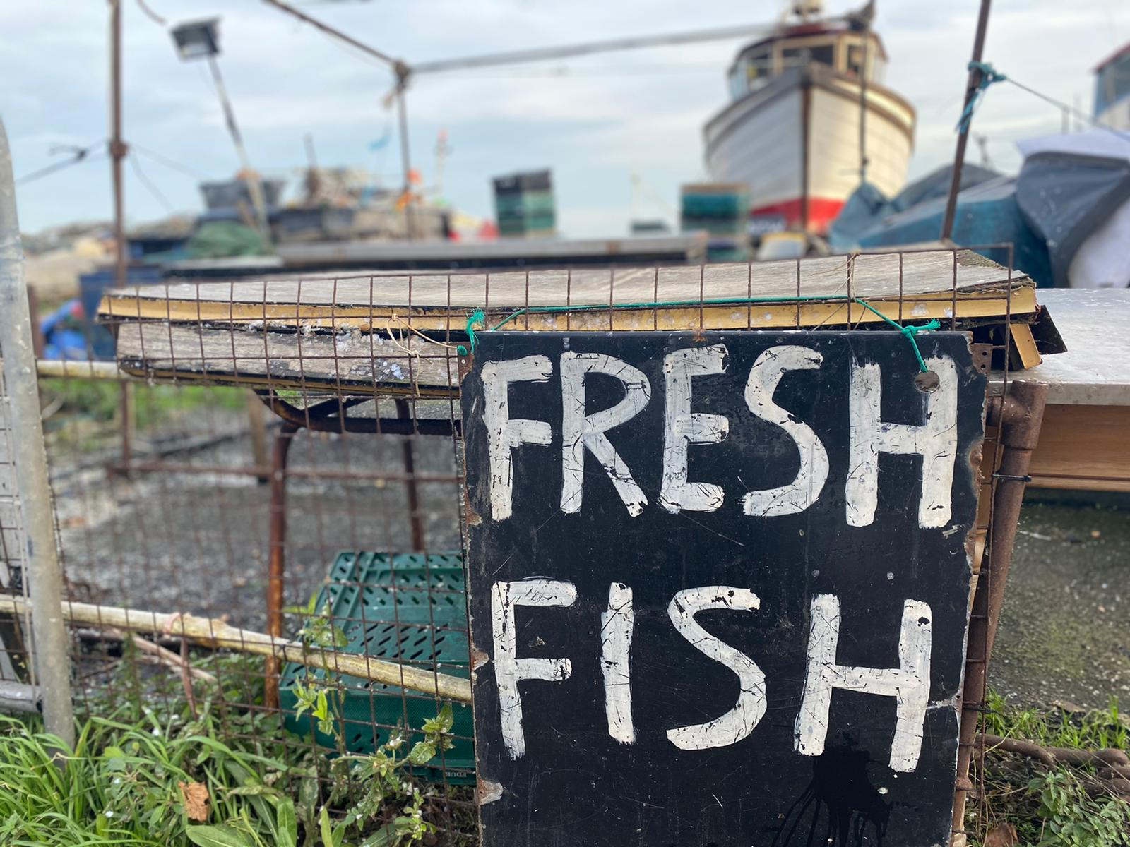Fresh Fish billboard sign outside harbour in Kent, England