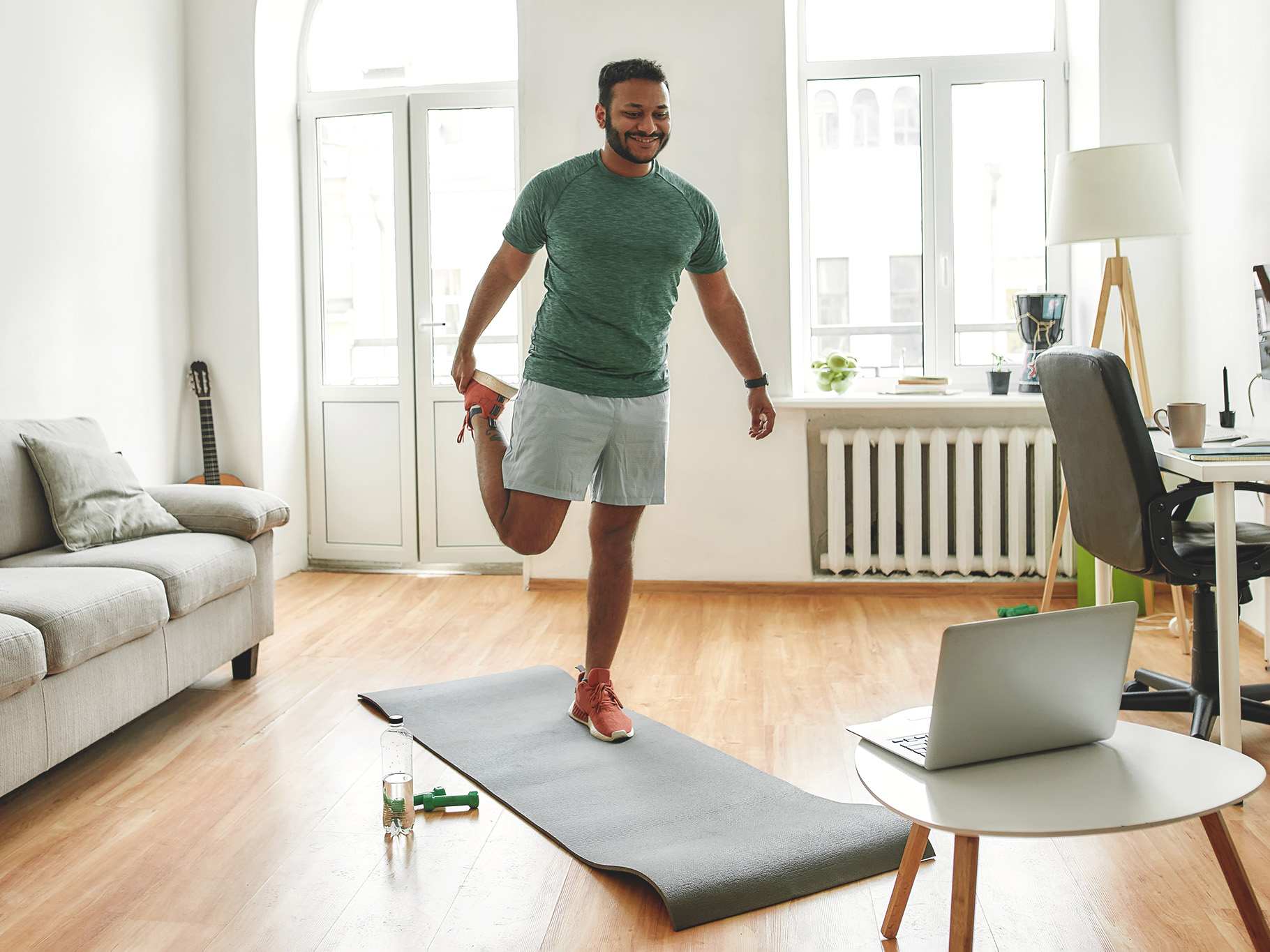 A happy guy doing online workout