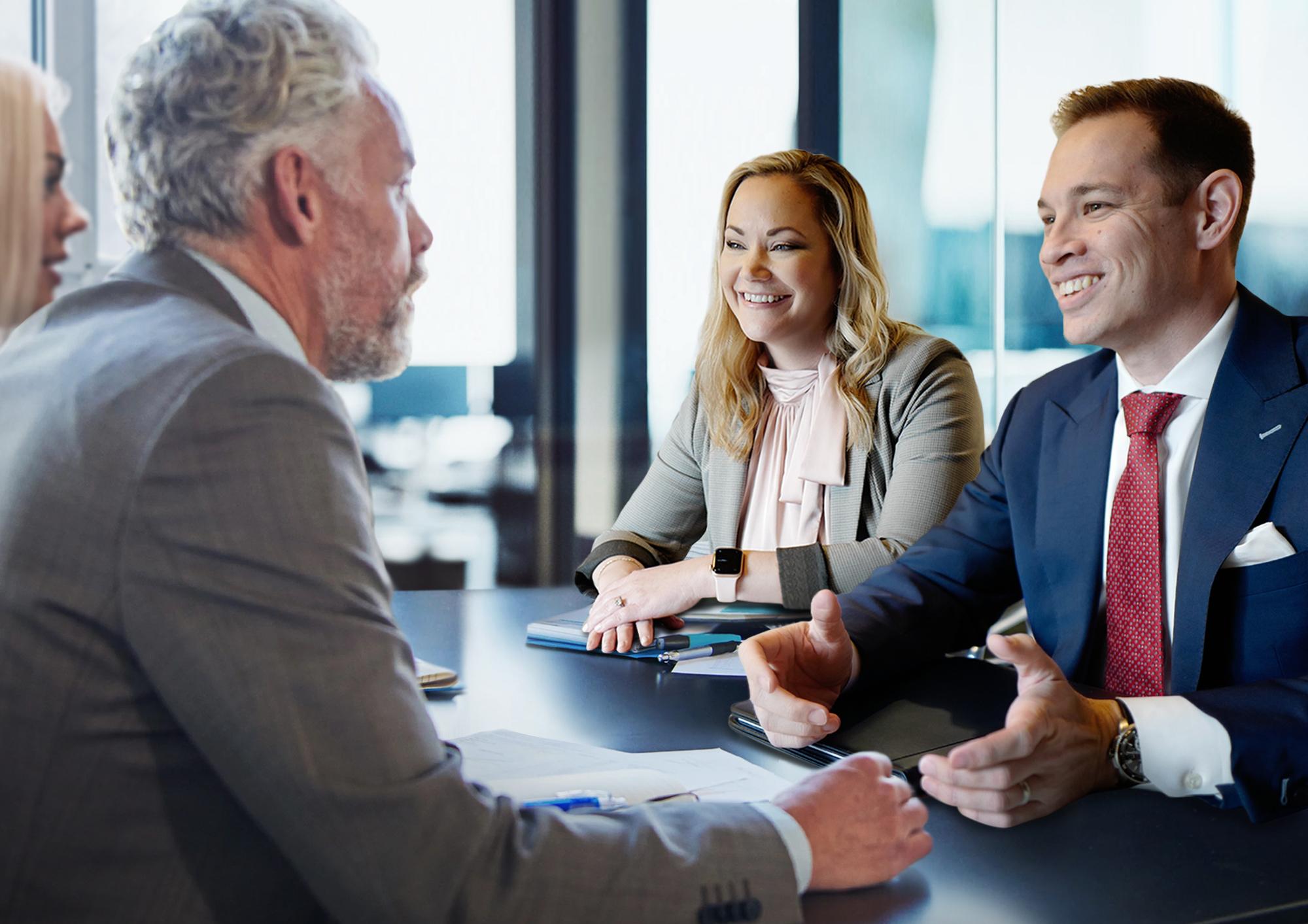 Johnathan Rankin and Melissa Rankin talking with clients