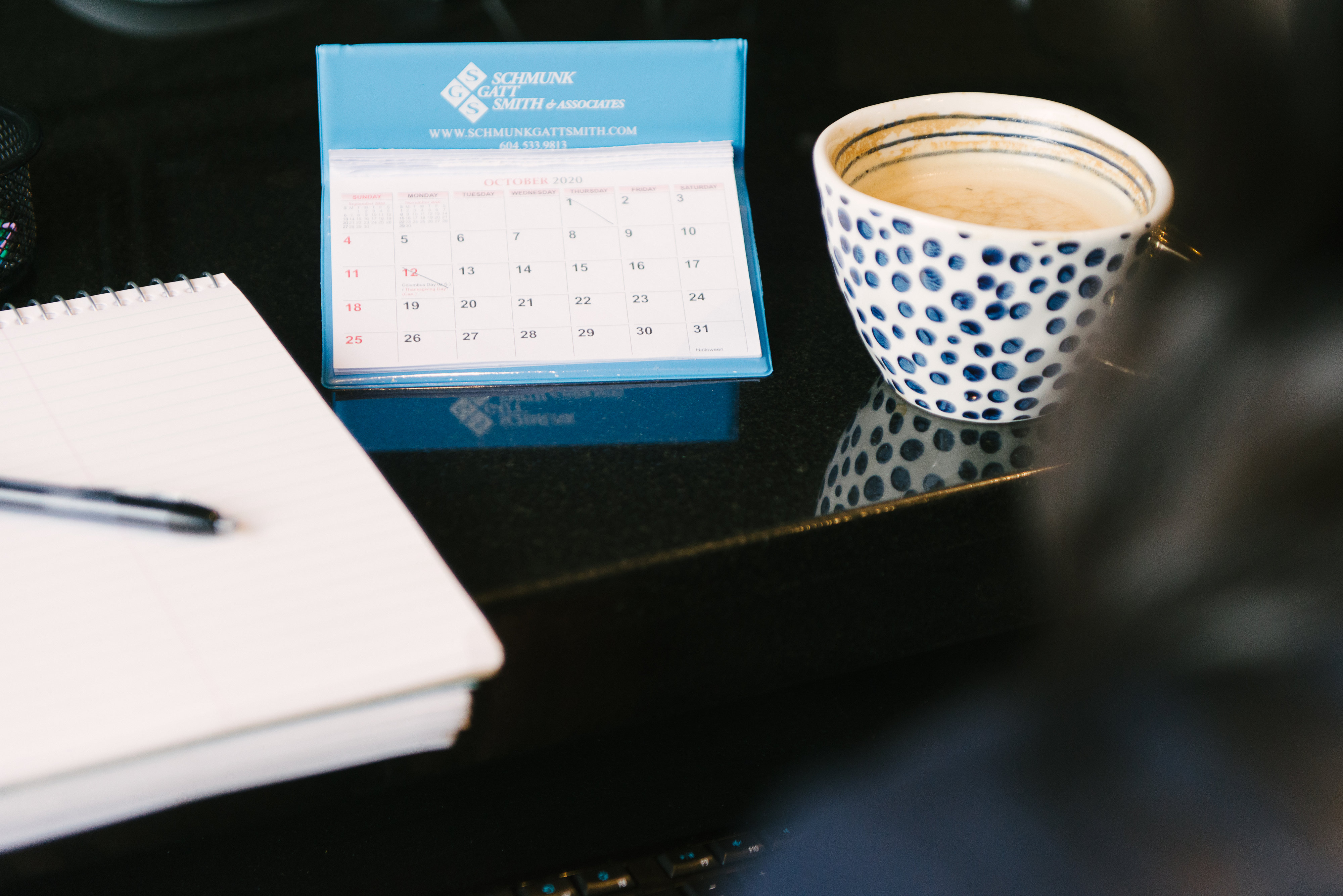calendar and a coffee cup in the table