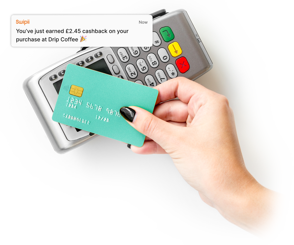 Hand scanning a contactless card on a card reader, with a notification of the transaction from Swipii