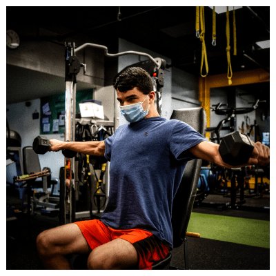 Joe Performing a seated Lat Raise at UTG Personal Training | Bergen County NJ