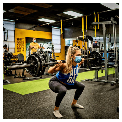 Nicole performing a barbell squat at UTG Personal Training | Bergen County NJ
