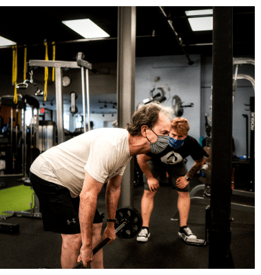 Personal Trainer Andrew watching Tom perform a romanian deadlift at UTG Personal Training | Bergen County NJ