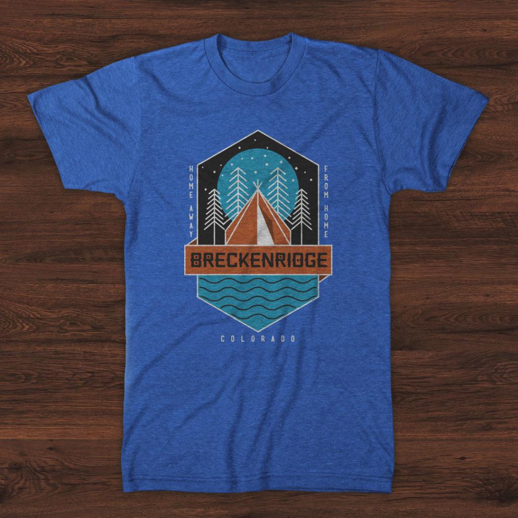 Blue Breckenridge t-shirt on wood