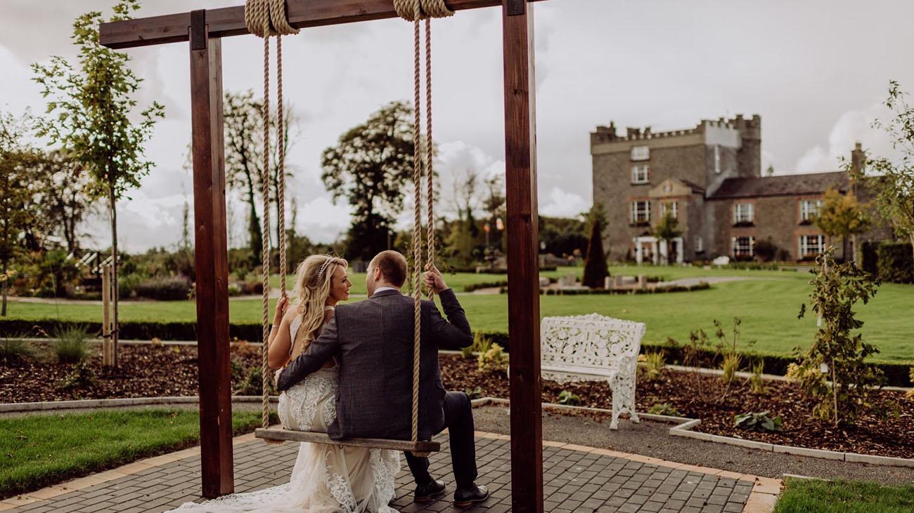 Darver Castle Bride and Groom on Swing in the Garden