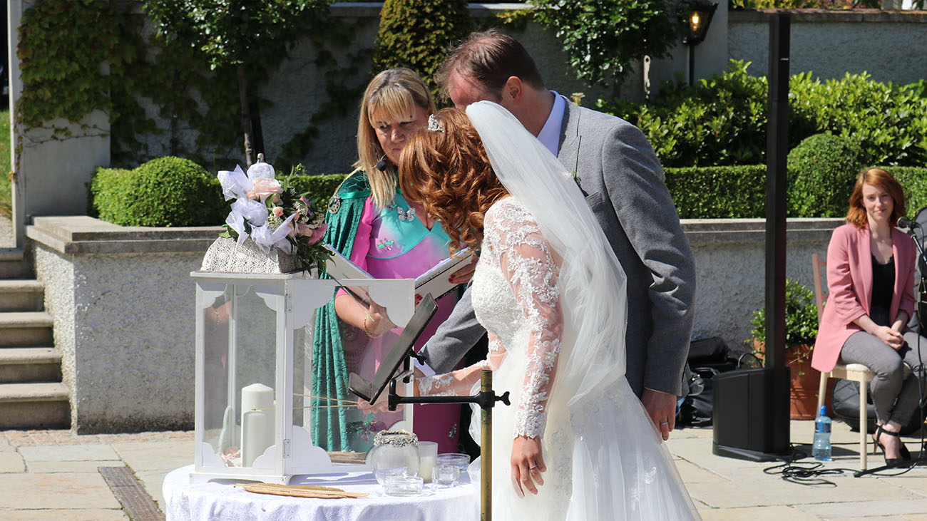 Reverend Lorraine McCarthy with Groom and Bride Outdoor Civil Wedding Ceremony