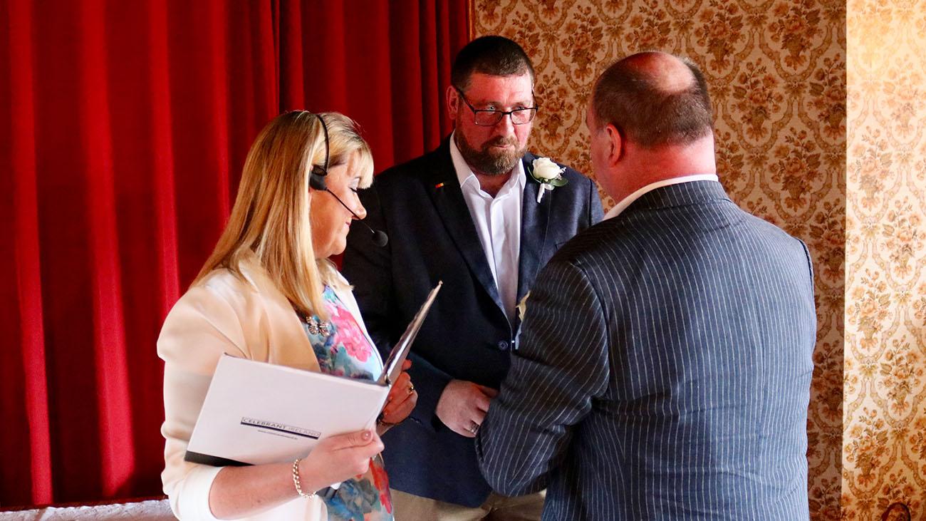 Reverend Lorraine McCarthy officiating a Same Sex Wedding