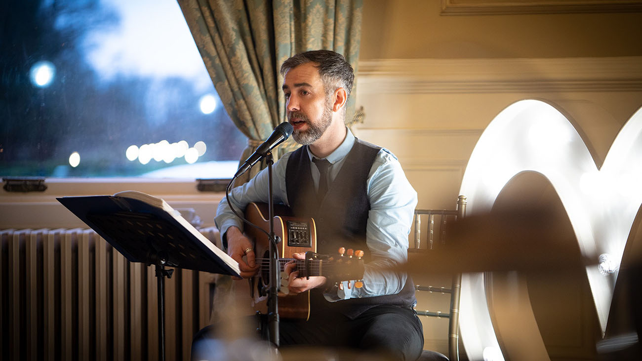 Barry Hughes playing Guitar and Singing at a Wedding