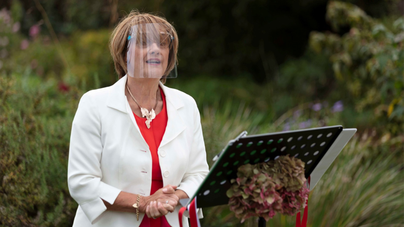 Reverend Marian Dooley in PPE carrying out a wedding ceremony