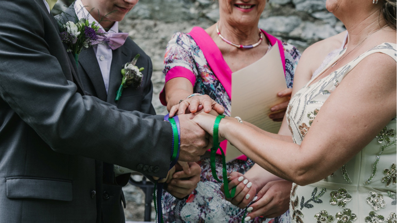 Reverend Marian Dooley carrying out a Handfasting