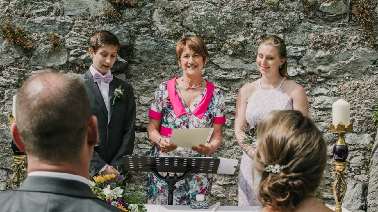 Reverend Marian Dooley with Wedding Couple
