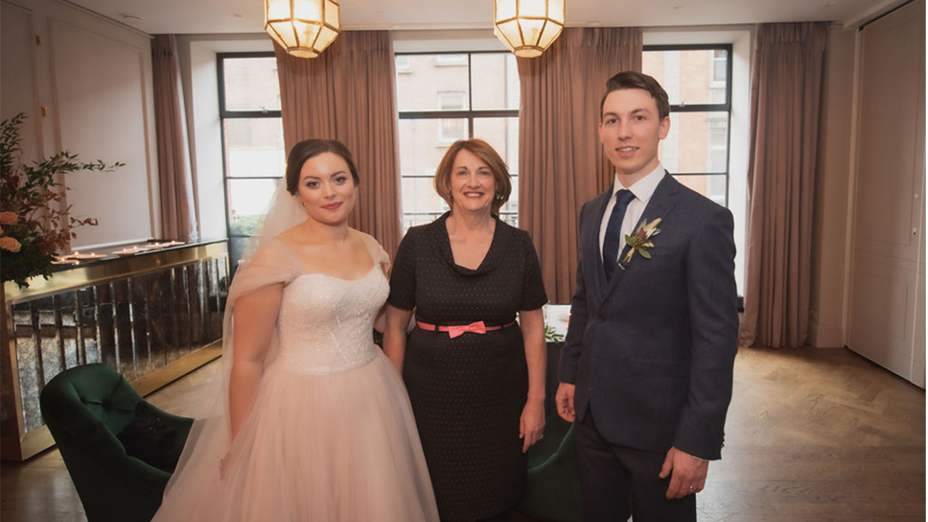Reverend Marian Dooley with Groom and Bride