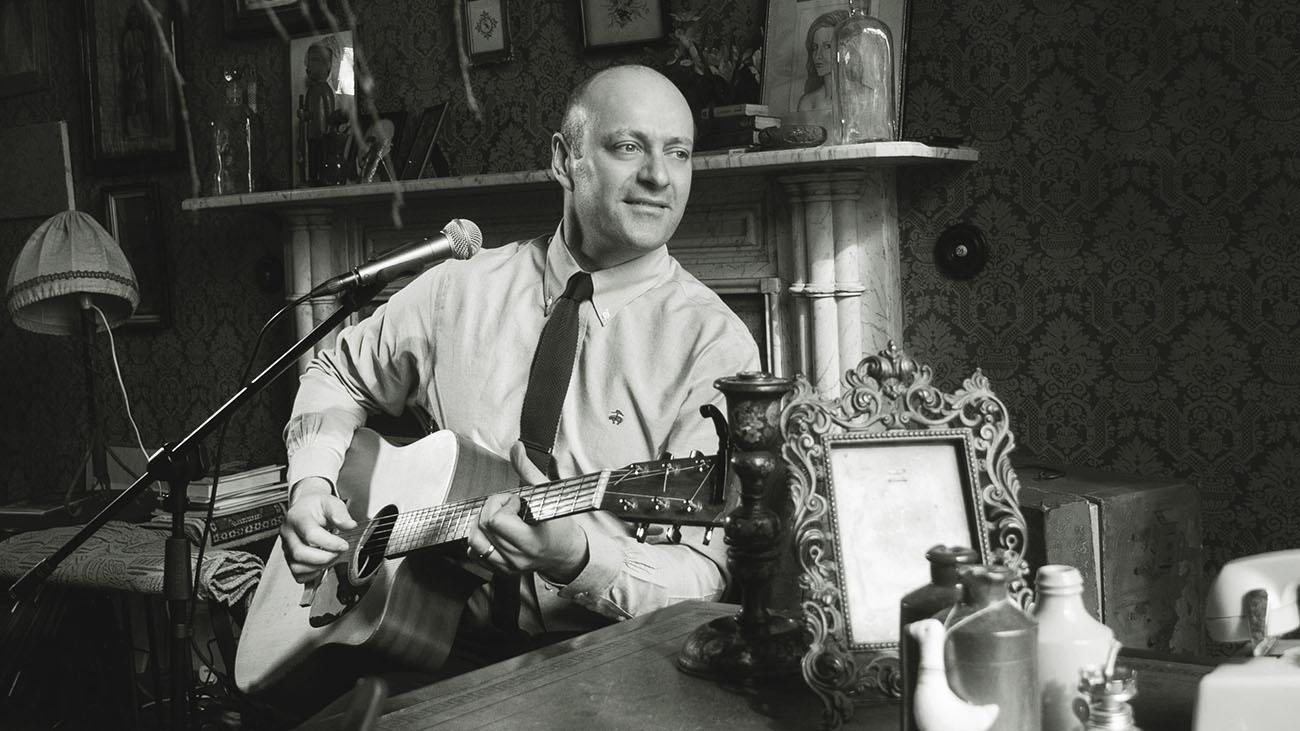 Graham Coe Playing Guitar and Singing
