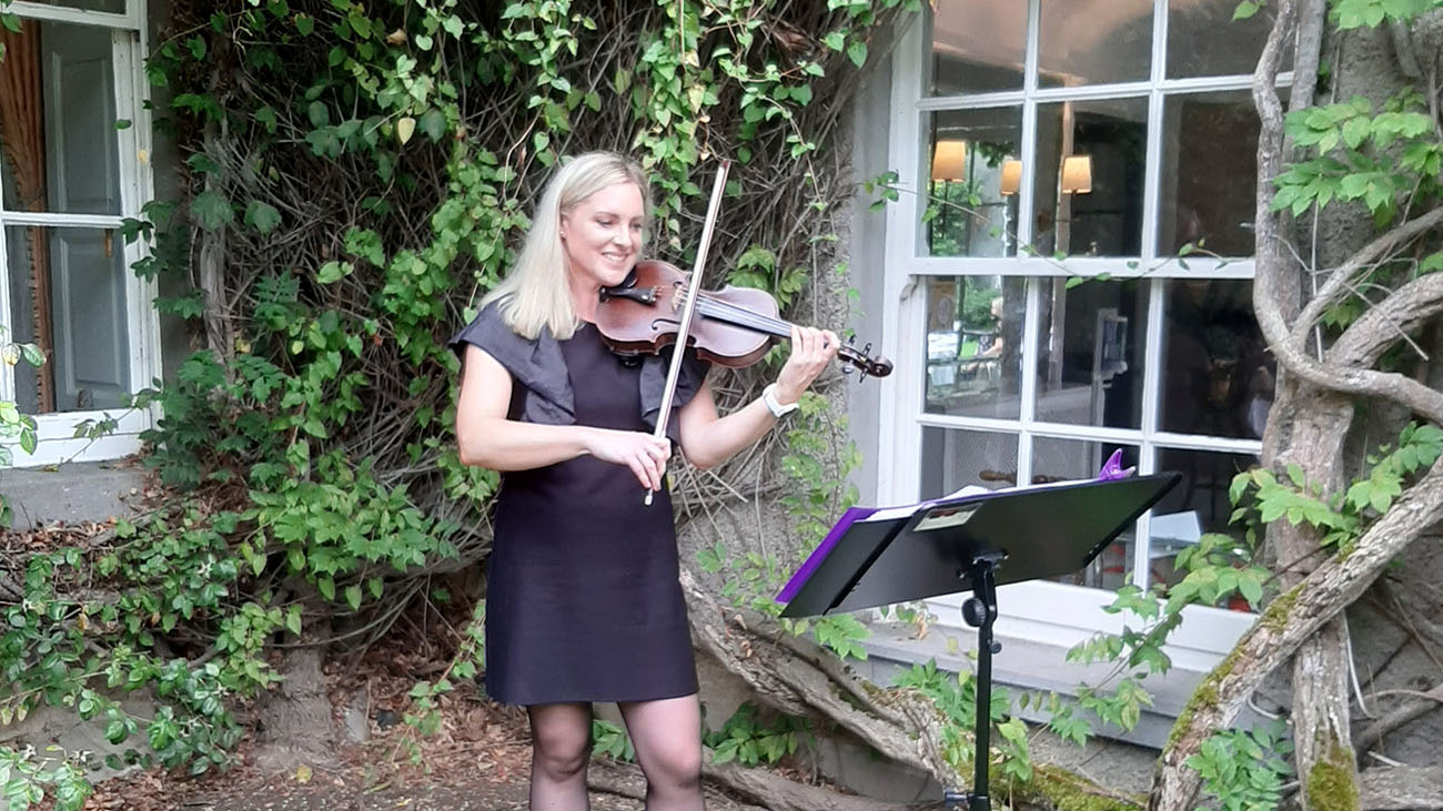 Hazel Alexander Violinist playing the Violin Outdoors