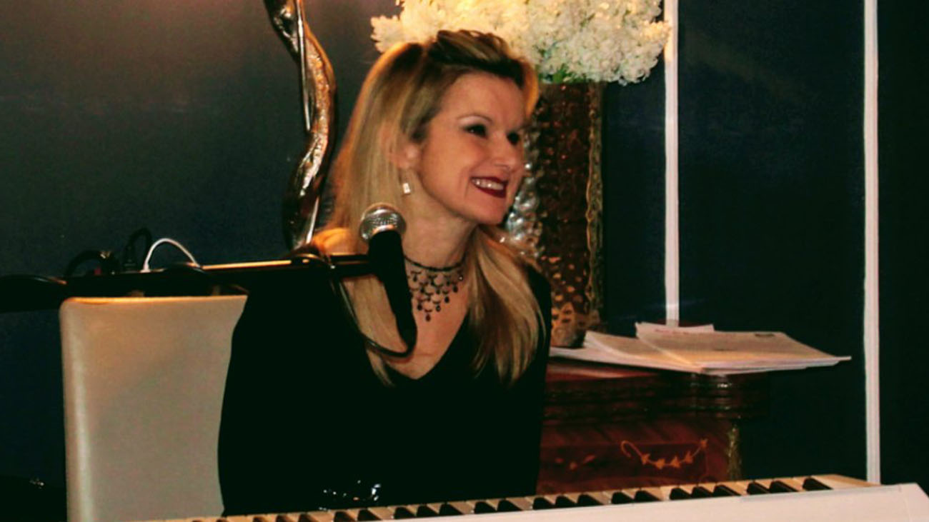 Stella Bass playing Piano at Wedding
