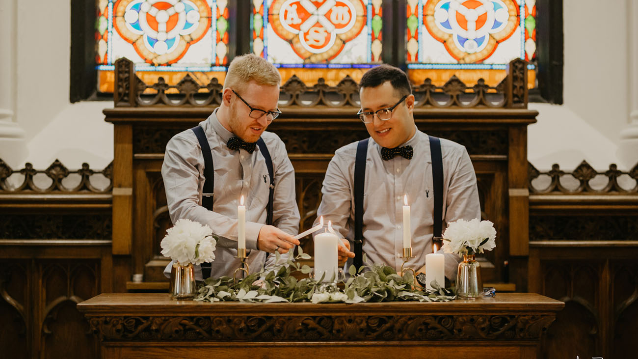 Gerrard's Church Same Sex Grooms Lighting Unity Candle of Marriage