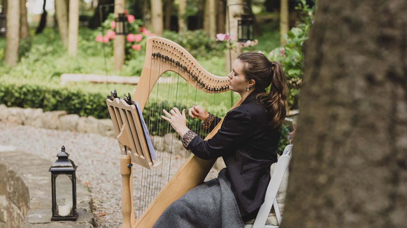 Rachel Reid Playing the Harp