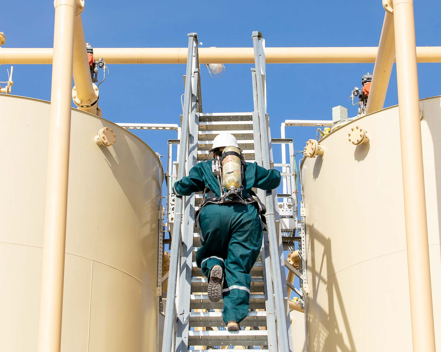 A worker protected by shepherd safety systems gas detection technology works at an industrial site