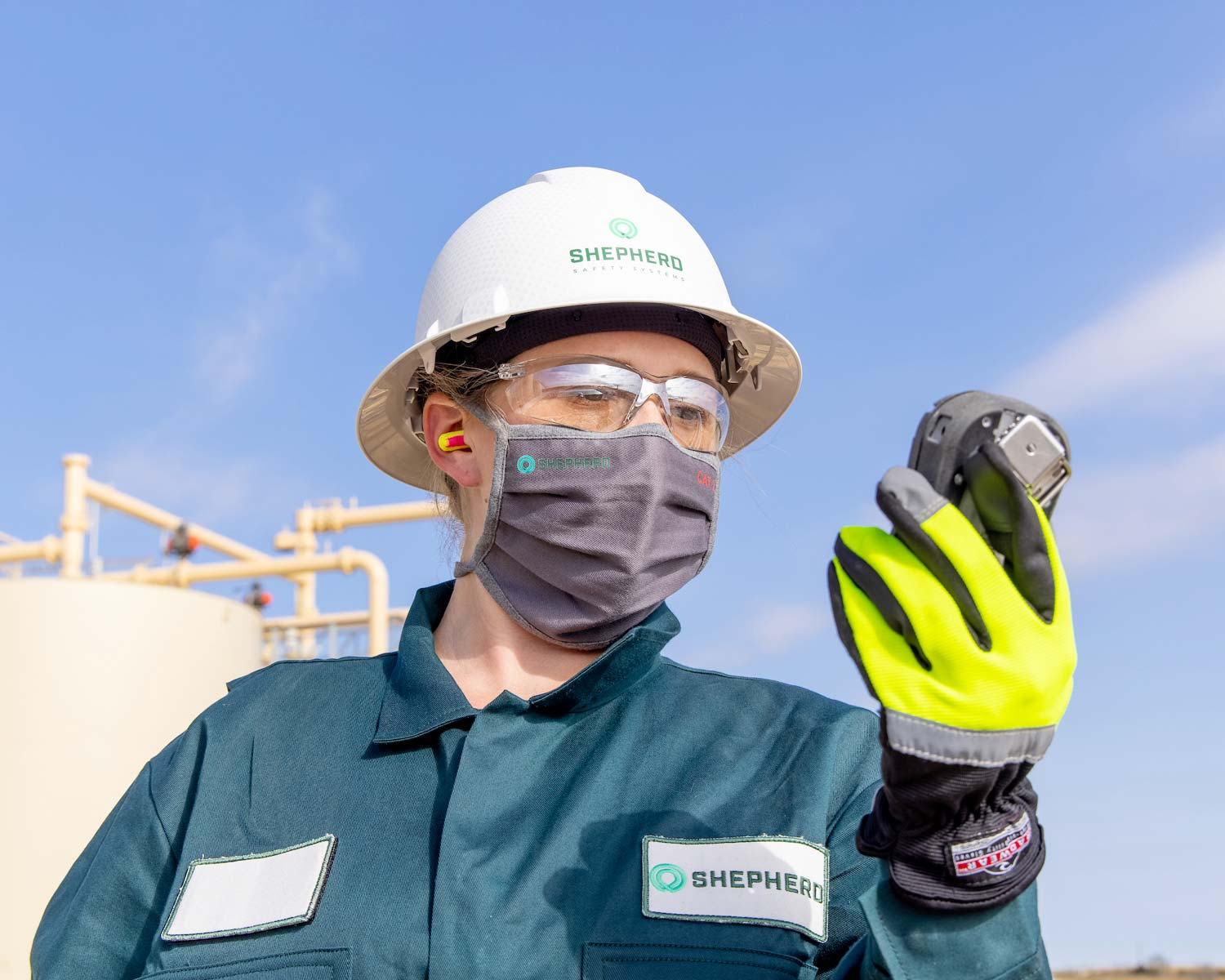 A shepherd worker monitors gas levels through a shepherd safety systems device