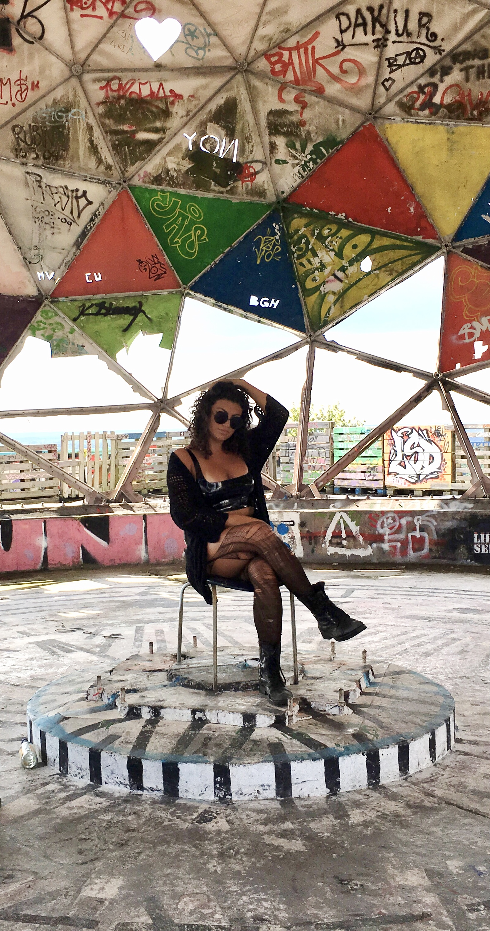Amy Lima, Product designer and UX/UI designer,  in an abandoned spy tower in Berlin