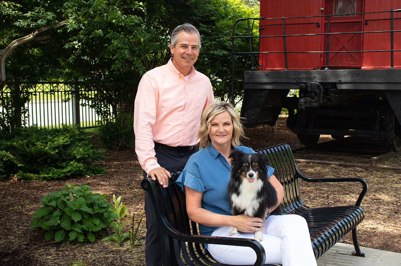 PrairieFire founder and CEO, Matt Meline, CFP®, his wife Lisa and their dog Shae.