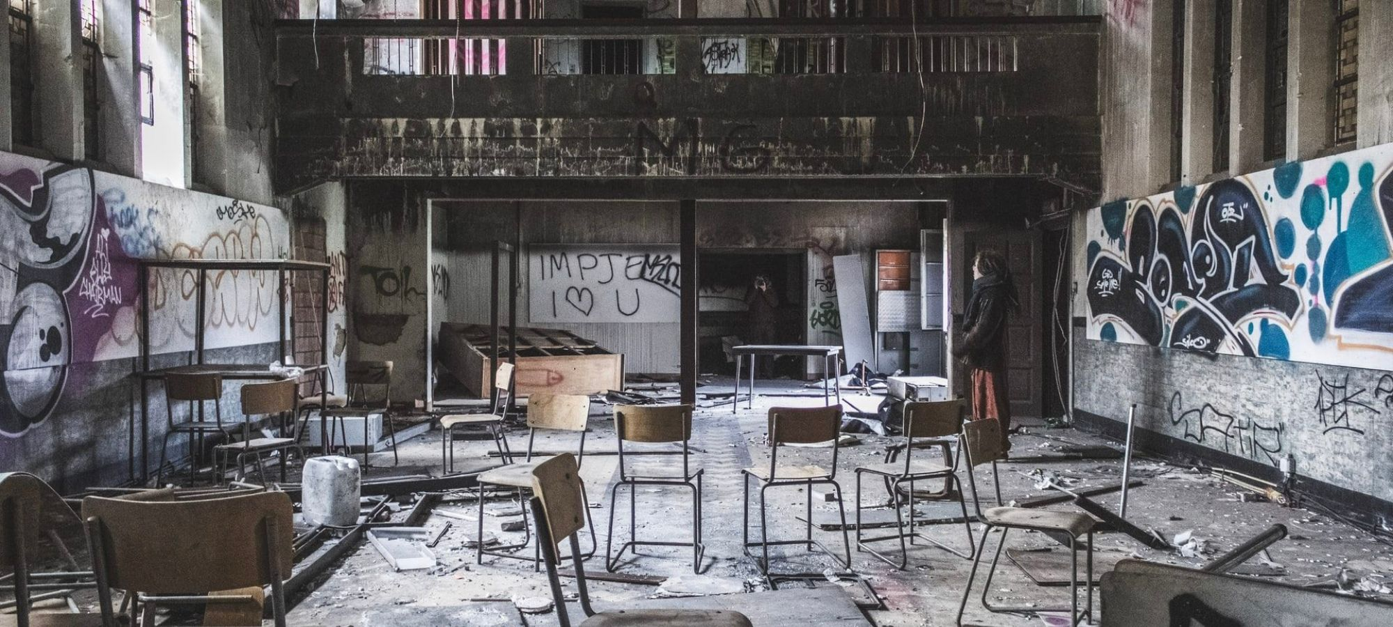 Inside an abandoned building in Doel, Belgium. Graffiti covers the walls and office chairs are spread about chaotically