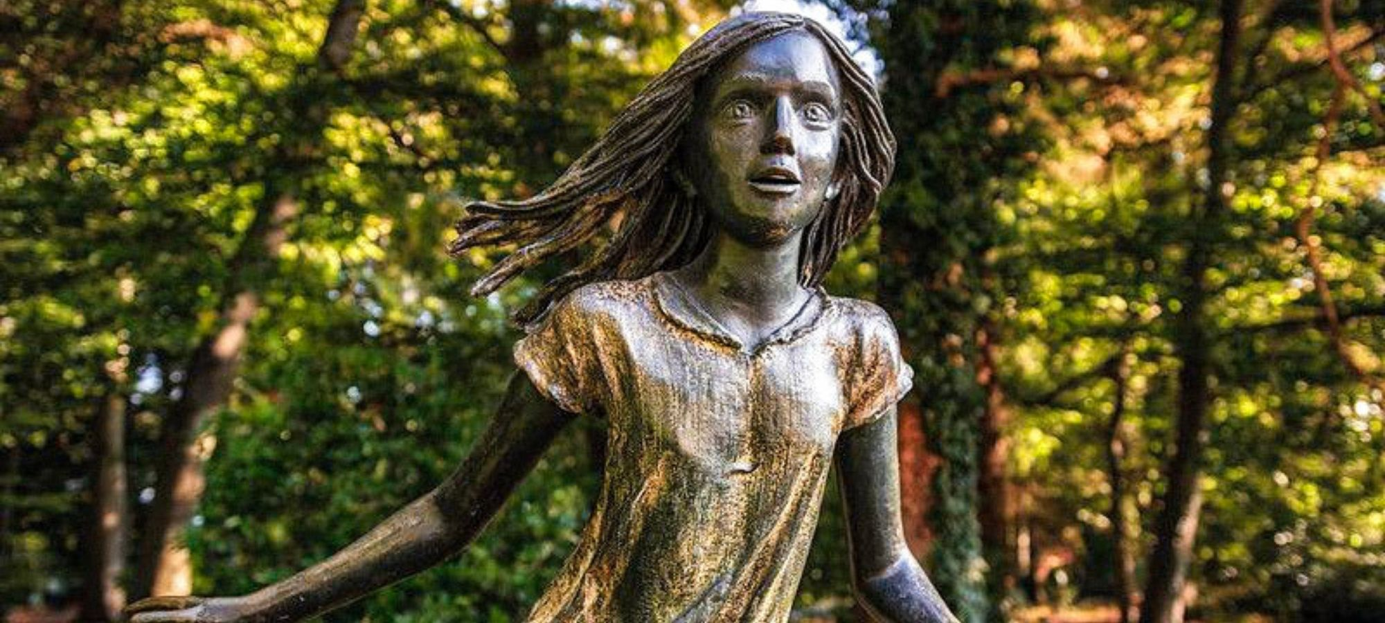Statue of a young girl running by Czech artist Kurt Gebauer from 1976 in Antwerp's open air park museum