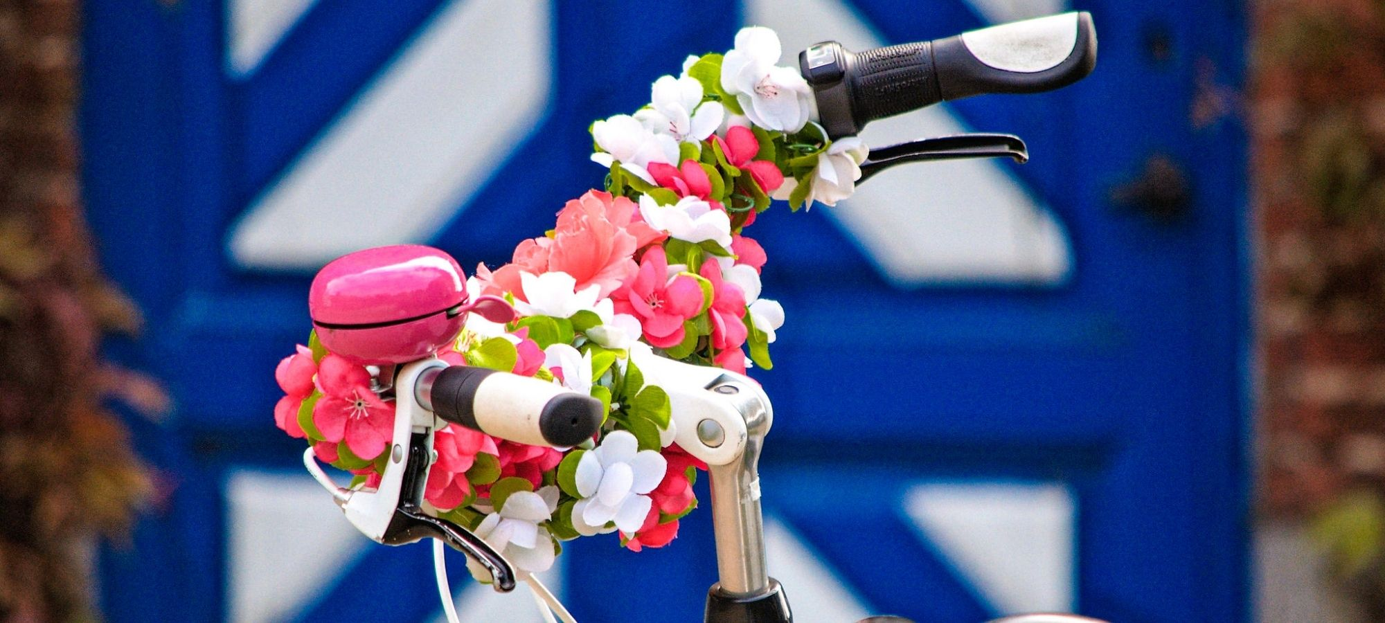 Bike with decorative flowers arranged on the handles. Bike is parked by the entrance gate to Domaine Tivoli, Mechelen