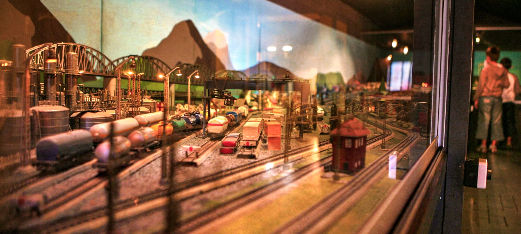 Toy train set and train station behind glass on display in toy museum, Speelgoedmuseum, Mechelen