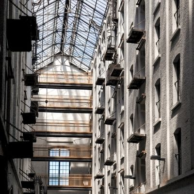 Inside tall, white archive warehouse with high glass ceiling in Antwerp, Felix Archive