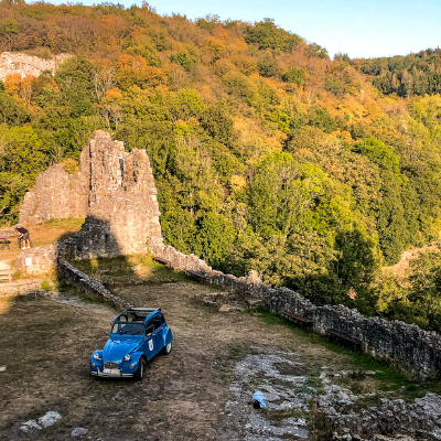 Blue Citreon 2CV on a rocky area in the Belgian countryside in spring