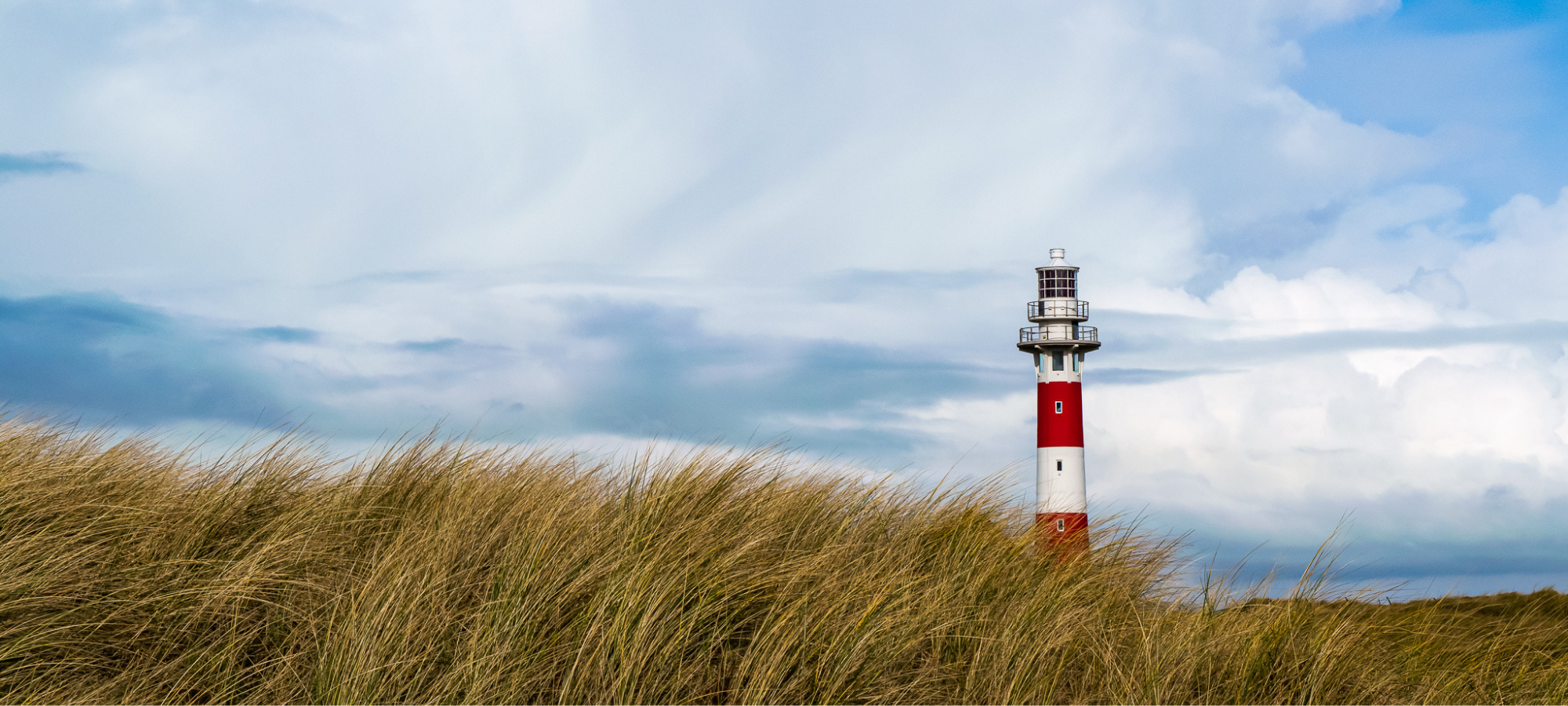 Nieuwpoort lighthouse standing out against the blue sky on the Belgian coast