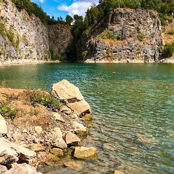 A pretty quarry hidden away by high cliffs in Floreffe.