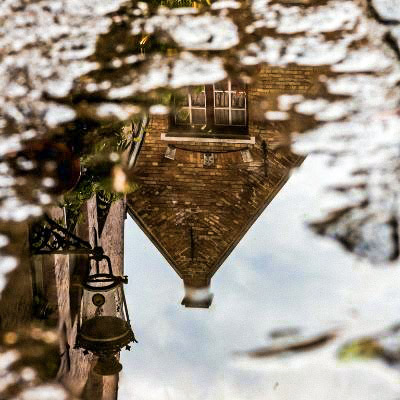 Reflection in a puddle of Bruges in autumn, Belgium