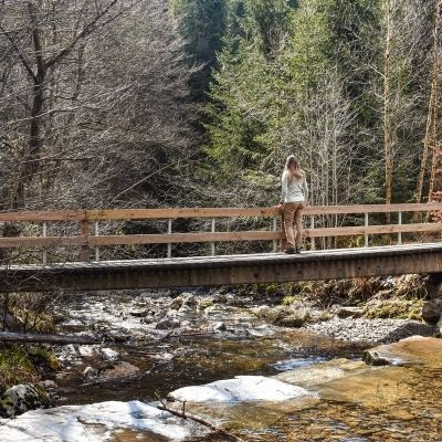 Woman on a bridge on a hike in the woodlands, Belgium