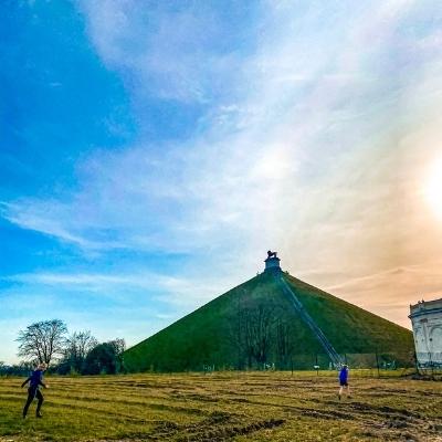 Kids running below the Lion's Mound, Belgium