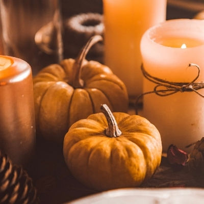Pumpkins, acorns, and candles on a table