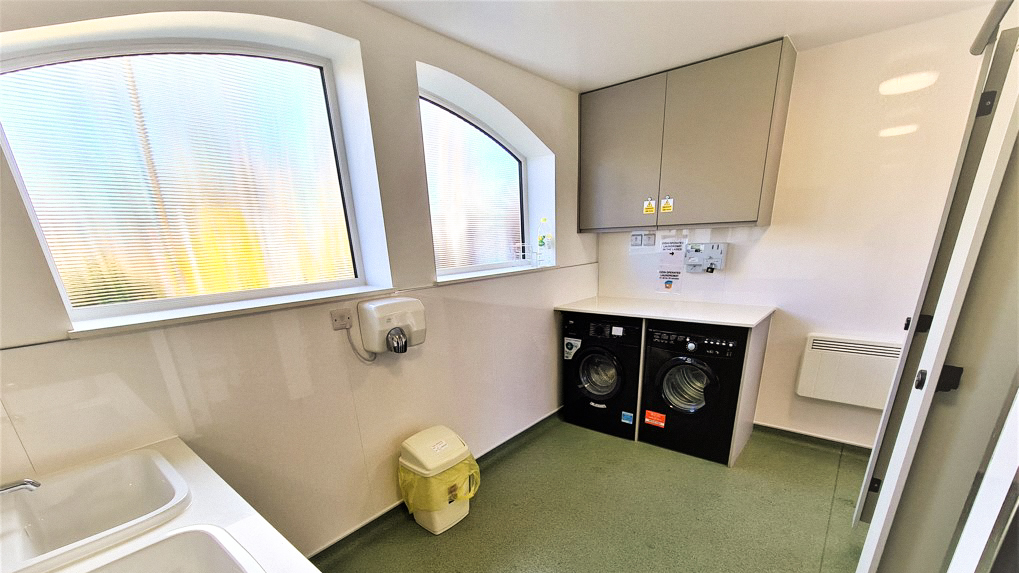 Fully refurbished toilet and shower block with washing machine and dryer