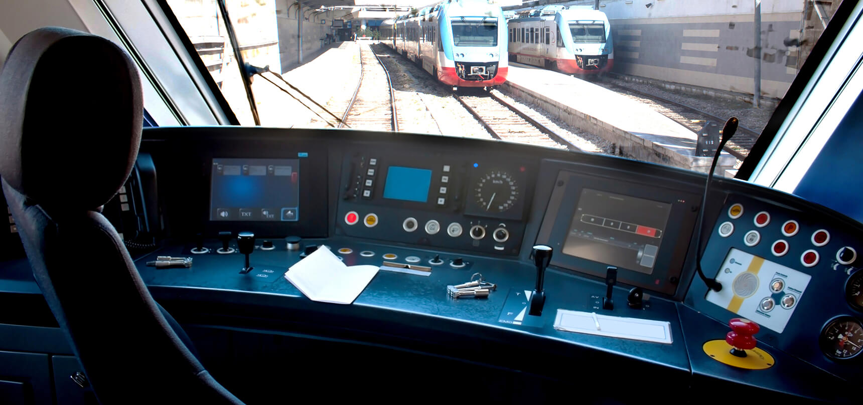 transportation industry train control panels and trains in the background
