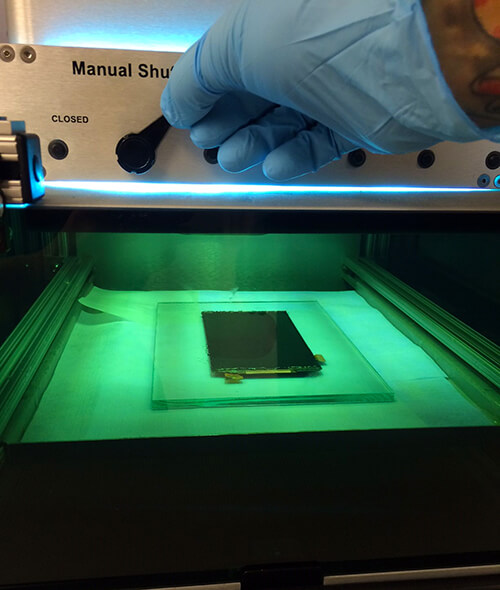 lcd with bond being cured in bonding machine