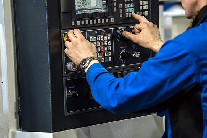 man using industrial lcd interface to operate heavy machinery