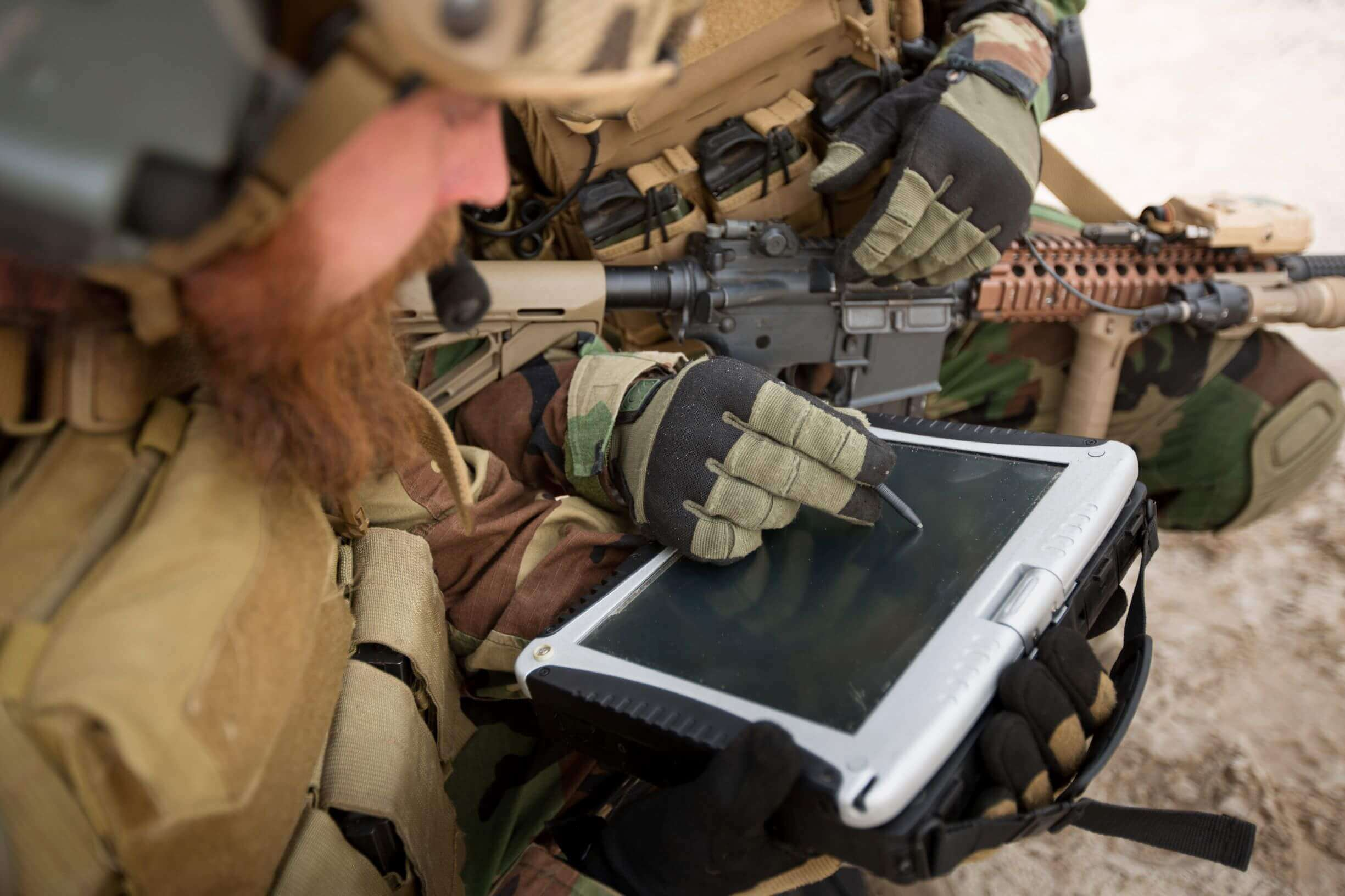 Military personnel using a rugged lcd laptop with a stylus pen