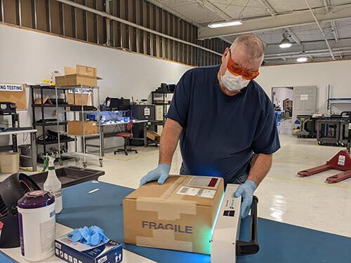 worker packaging shipments