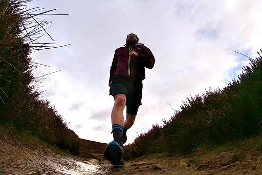 a man running toward to the camera